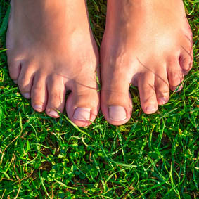 close-up of female feet on grass